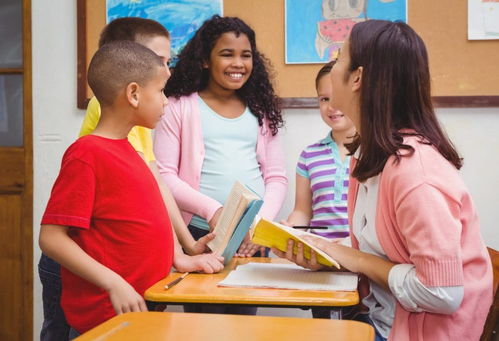 children smiling, laughing, classroom