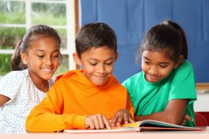 children reading together buddy group shared reading