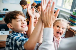 students happy high five teacher excited hands raised-2015